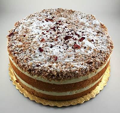 Crixa Cakes' Amaretti Cream Cake on top of gold plate