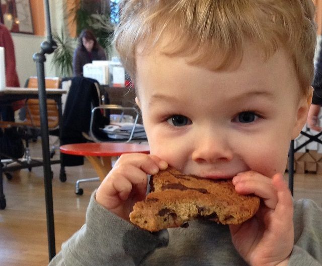 Happy child with a cookie