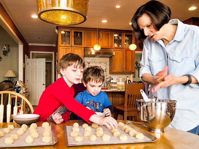 Children helping grandma make cookies
