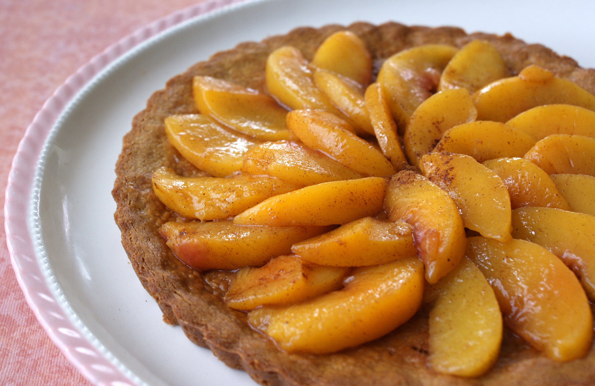 Homemade peach tart on a white plate