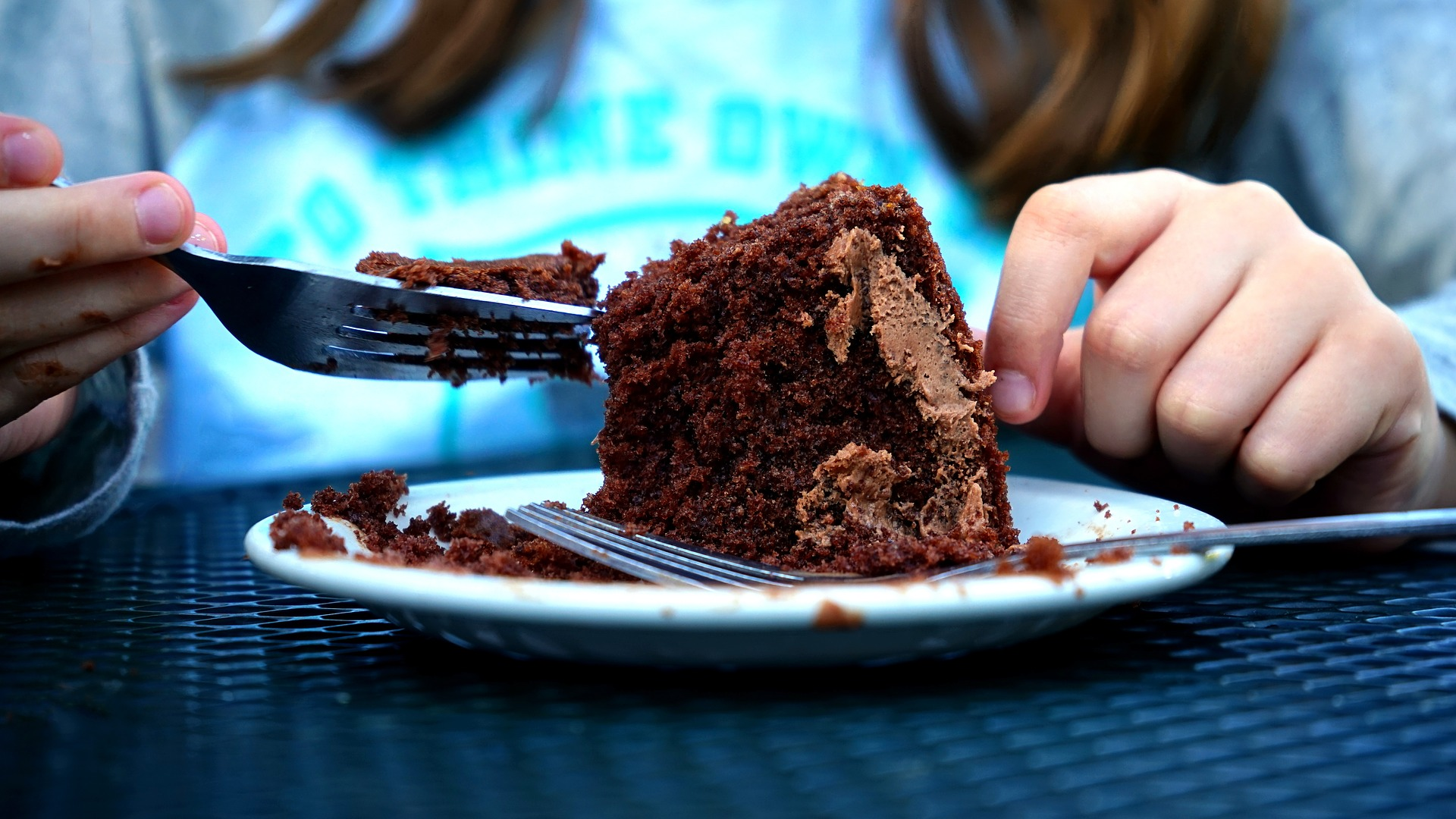 Girl eating a chocolate cake