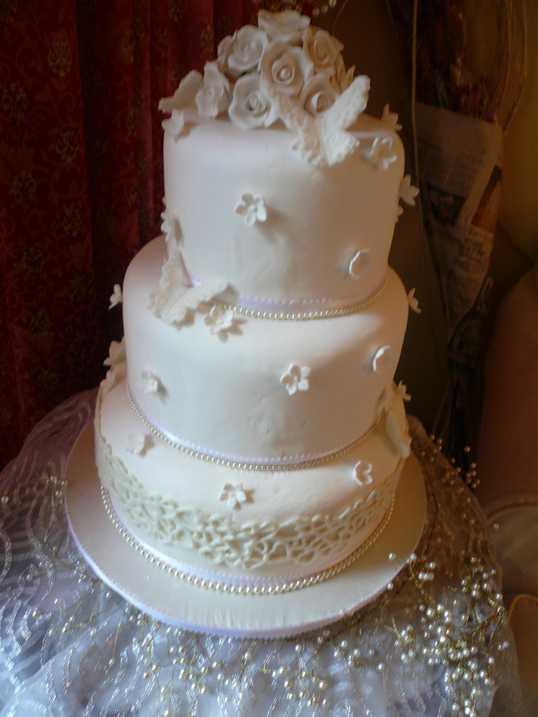 wedding cake decorated with fondant and roses