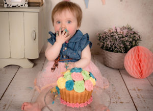 a baby eating an sweets