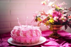Gorgeous Pink Cake with three candles