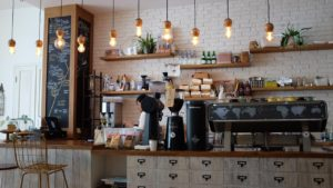 Barista behind a cafe counter