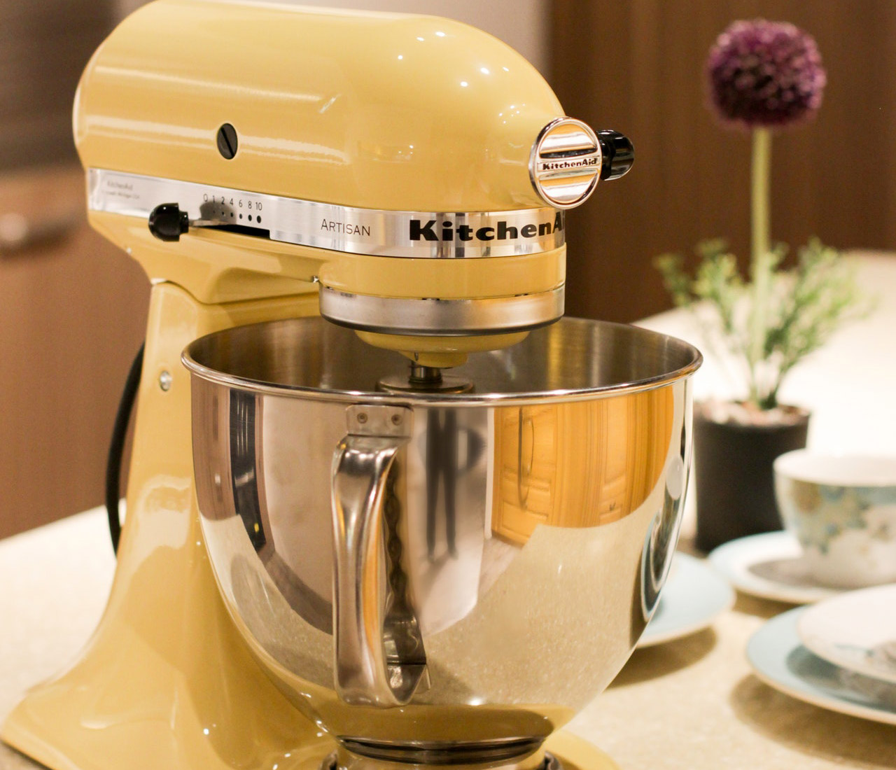 yellow kitchenaid stand mixer on the table