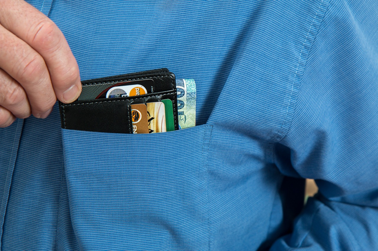 Hand picking the wallet on the pocket