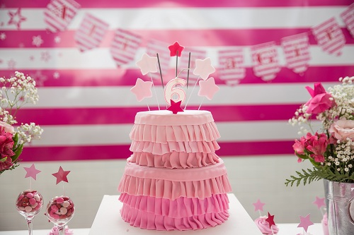 pink cake with a number 6