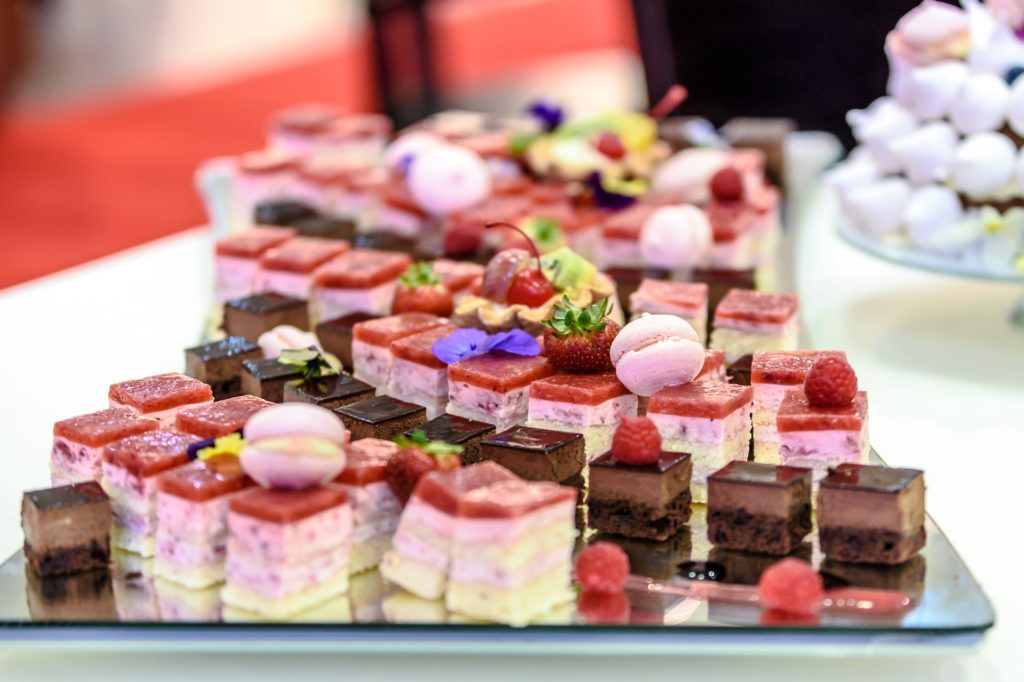 A table with a variety of desserts.